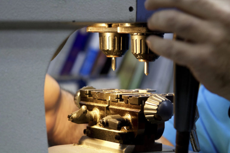 A person working on a fabricating machine